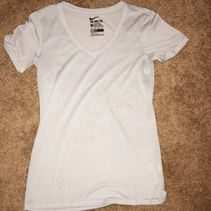 Gray and white striped Nike top